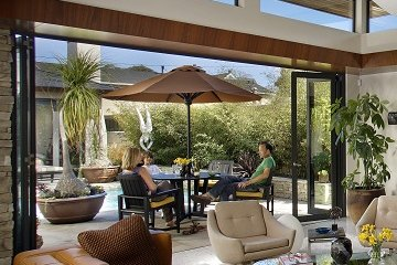 Contemporary Open Door Concept Aluminum Folding Glass Door leading to Outdoor Patio. By Lanai Doors™