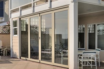 Movable glass wall seperating california patio from pool. Aluminum Accordian folding doors.