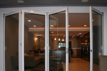 Condo living room with open concenpt design sliding door.  Brick Patio.