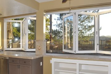 Built in shelf for kitchen with large opening bi-folding white aluminum windows. Custom Kitchen design.