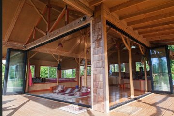 Adult tree house studio loft with movable wall accordian bi-fold doors. Naturalist Style home. Rustic design.