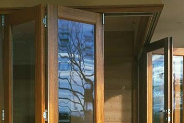 Wood bi-folding accordian door. Makes an open concept floor plan with glass walls.