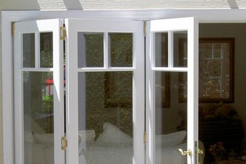 Three Lite white accordian french door. Sliding door to patio.