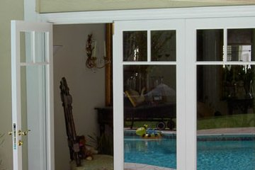 Wood sliding french door with three lites. White wood.