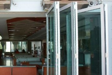 Commercial folding door Reception patio for entertainment space seamless transition. ADA Compliant. Egress Door.