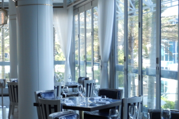 Modern hotel restaraunt with hurricane proof glass walls bifolding accordian doors. Miami Dade certified.